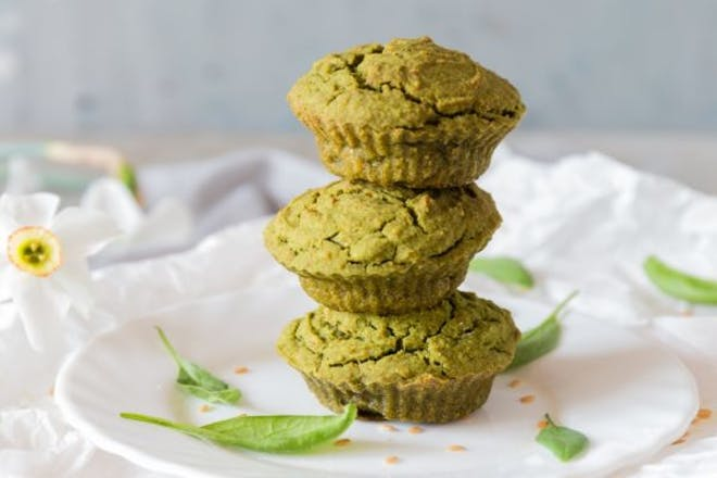 Stack of three spinach muffins on a plate