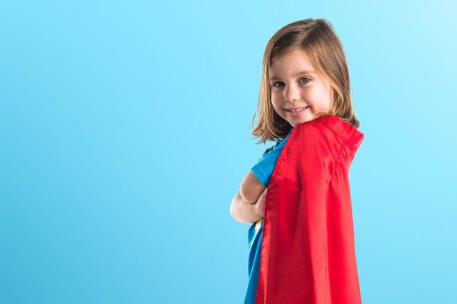 Girl wearing homemade cape