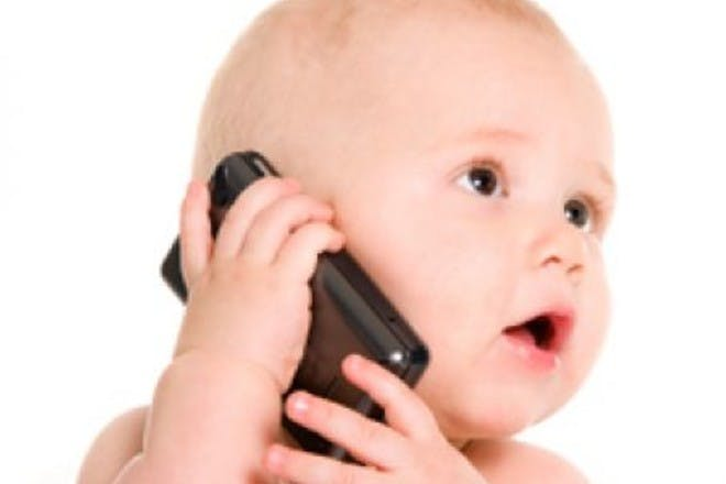 baby holding mobile phone to ear