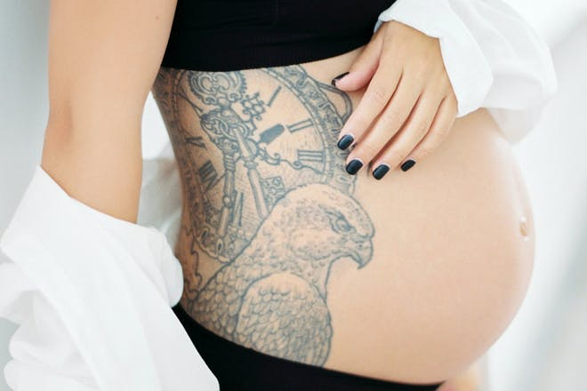 Pregnant woman with tattoo