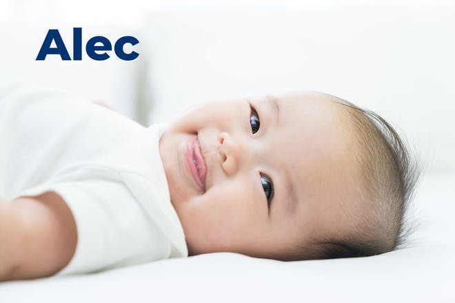 Baby smiling and sticking tongue out. Name Alec written in text