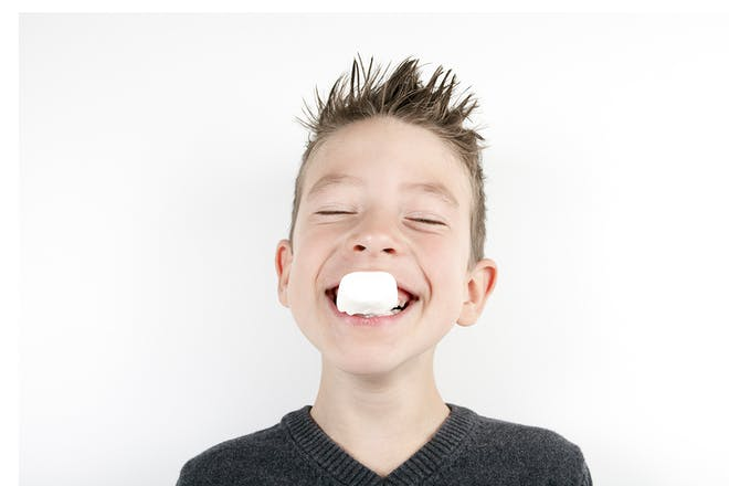 Boy with marshmallow in mouth
