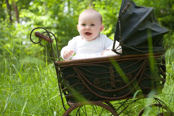 baby in old-fashioned pram