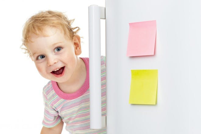 child looking in fridge