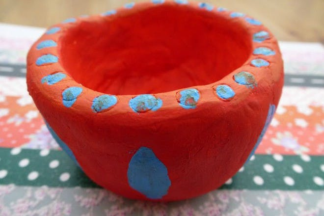red and blue clay pot