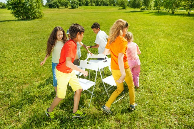 Kids playing musical chairs outside