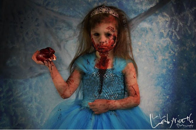 girl made to look like a zombie holding a heart