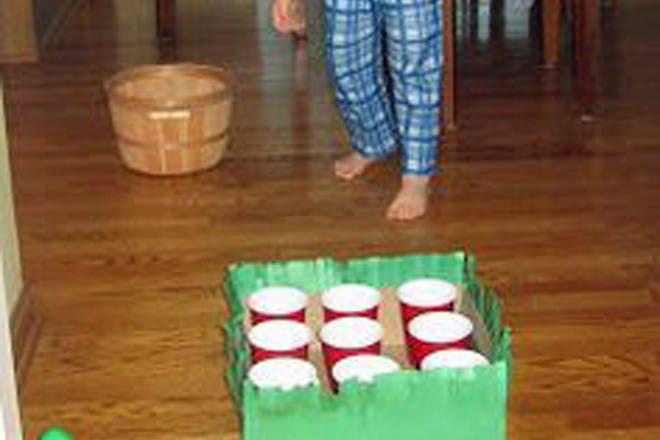 Child playing egg pong