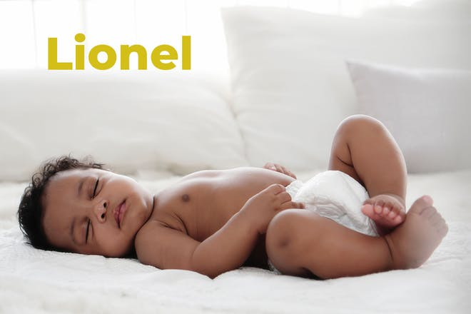 Baby lying on back sleeping. Name Lionel written in text