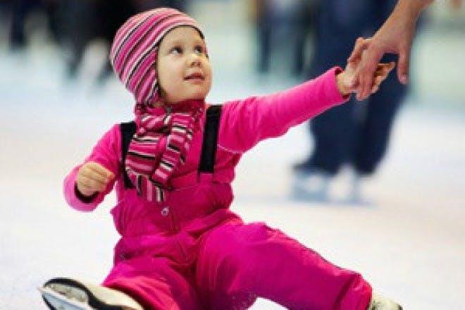 girl in pink ice skating