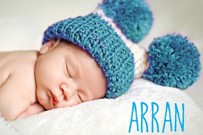 baby with hat on sleeping