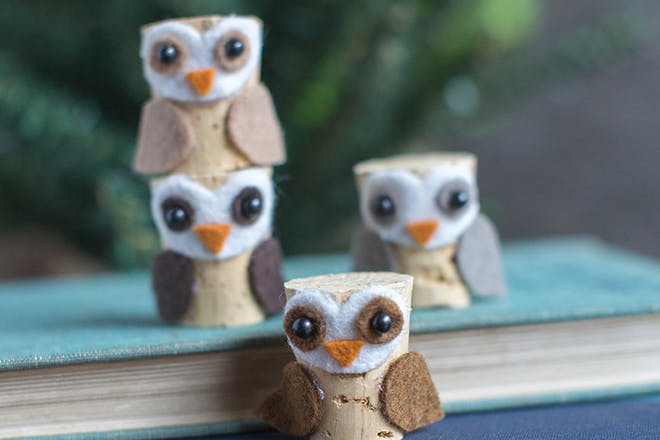 Owl craft made from felt material and wine bottle corks
