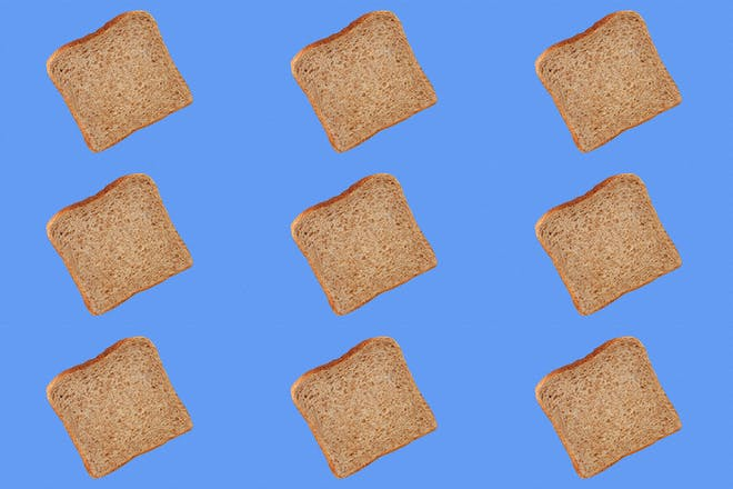 Slices of brown bread on blue background