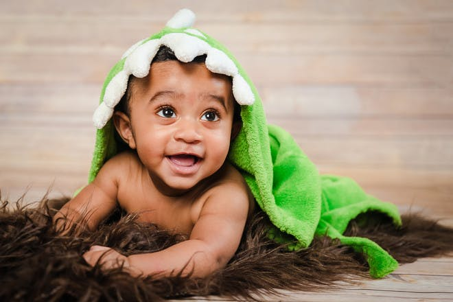 Baby boy with dinosaur towel