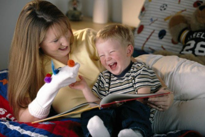 baby and mum laughing at sock puppet