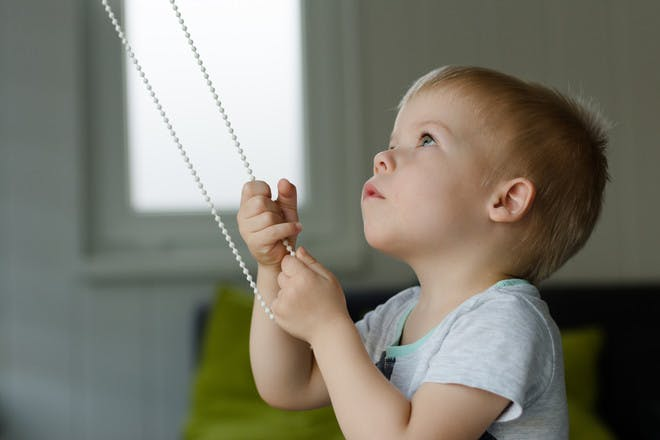 Child pulling blind cord