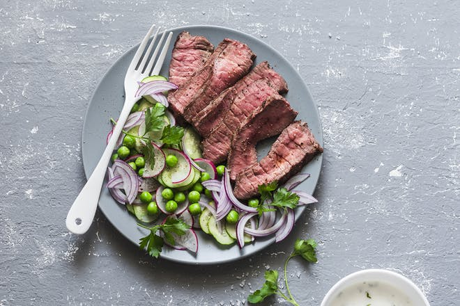 Slices of beef on plate with salad