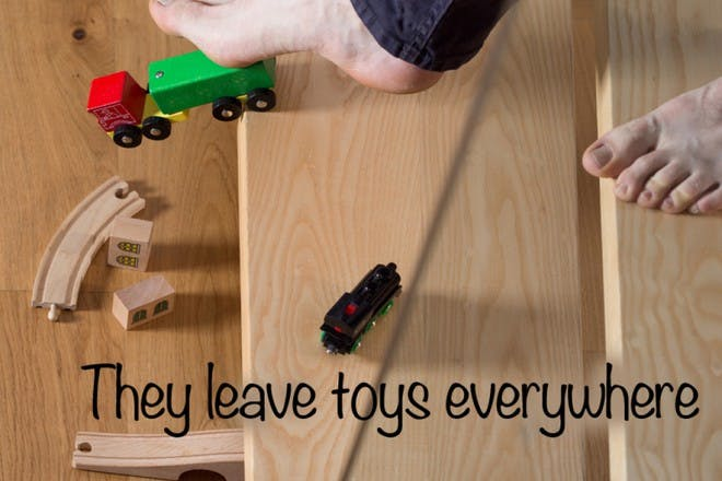 walking down wooden  stairs with toys on floor