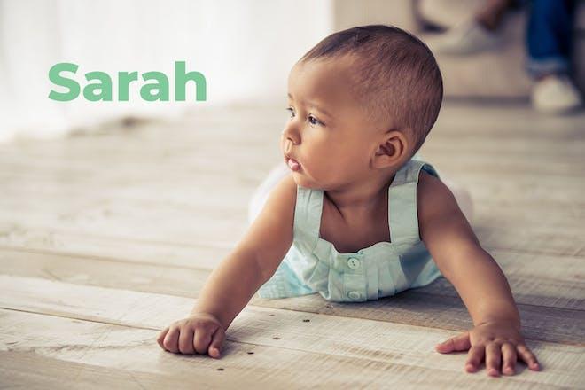 Crawling baby. Name Sarah written in text