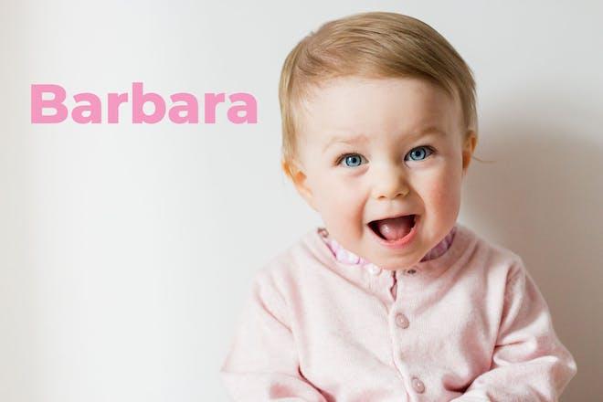 Baby sitting up wearing pink cardigan. Name Barbara written in text