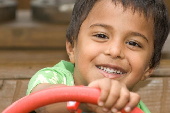 boy in green shirt smiling
