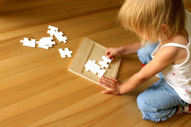 little girl doing jigsaw