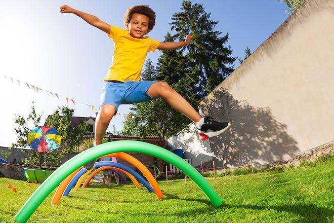 Boy doing garden obstacle course
