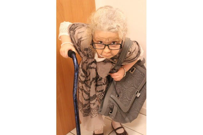 little girl dressed up as old woman