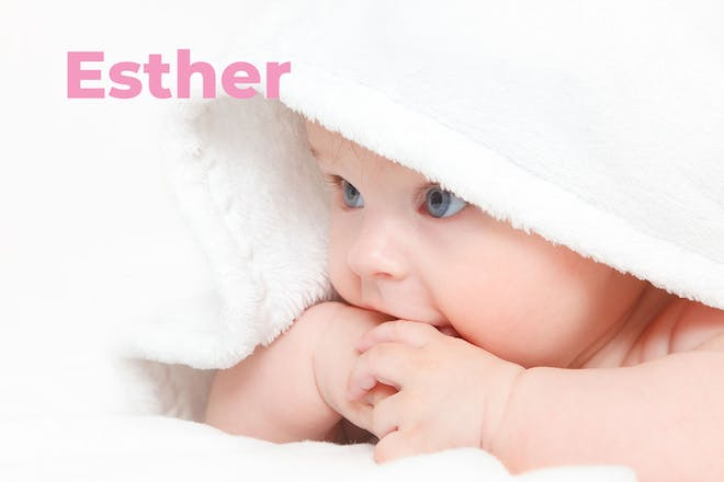 Baby in hooded towel. Name Esther written in text