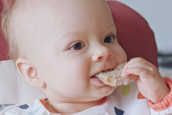 Baby having snack during weaning