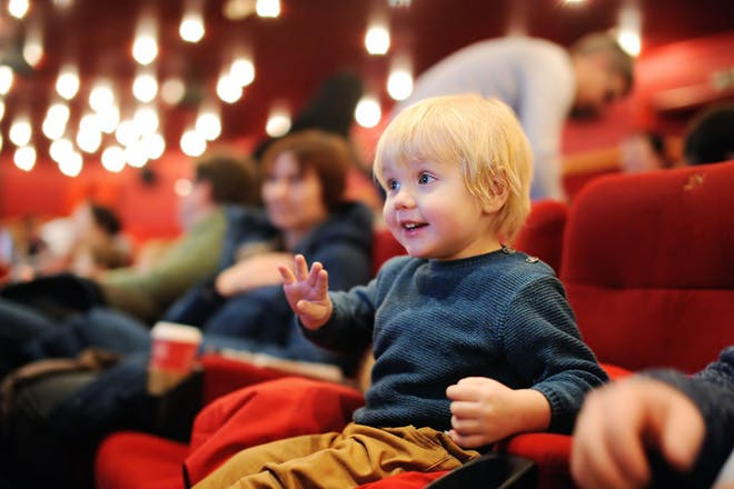 little boy at the theatre