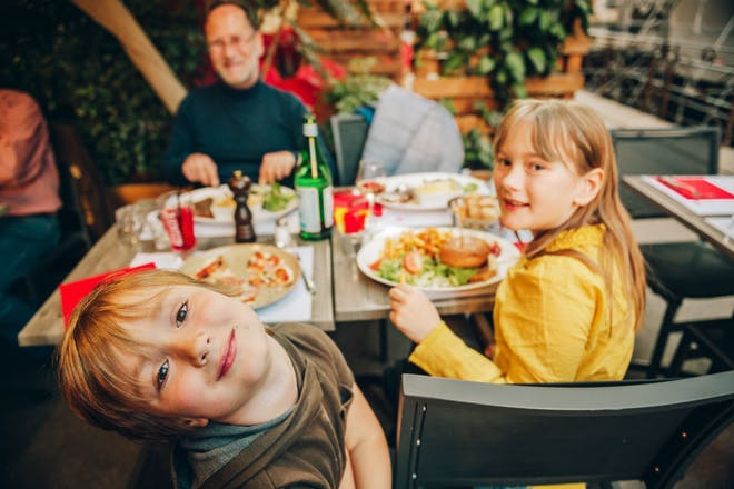 Kids eating outdoors at a restaurant