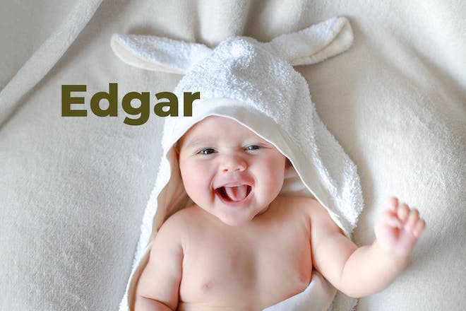 Baby in hooded bath towel with name Edgar written in text