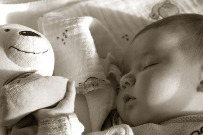 baby sleeping with toy