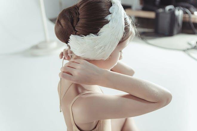 Little girl dressed as the white swan