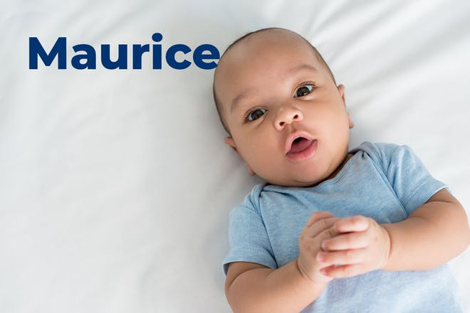Baby in blue baby gro. Name Maurice written in text