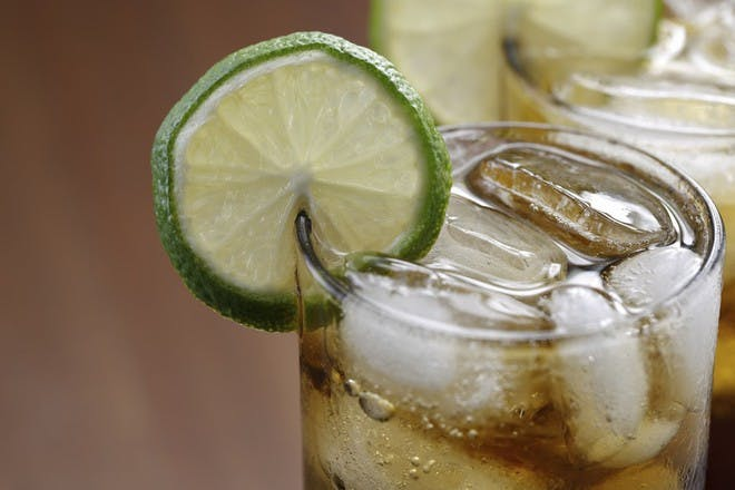 cola in glass with lime slice