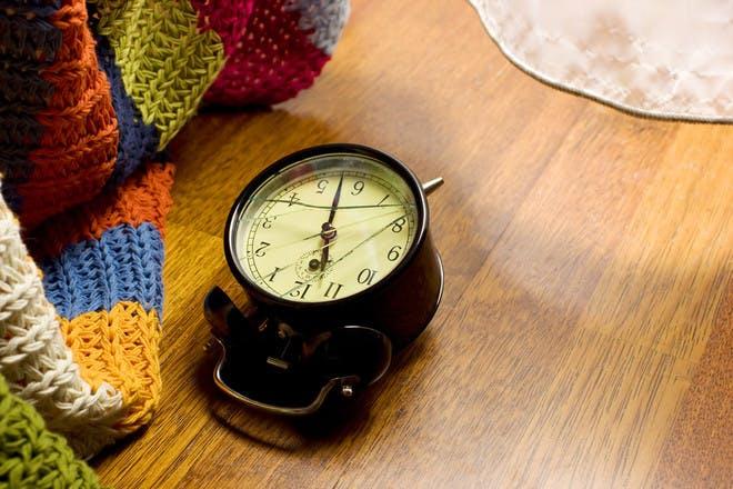 broken clock on wooden floor