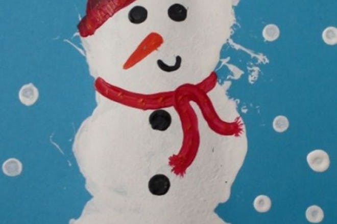 snowman painted using cotton wool and cotton buds
