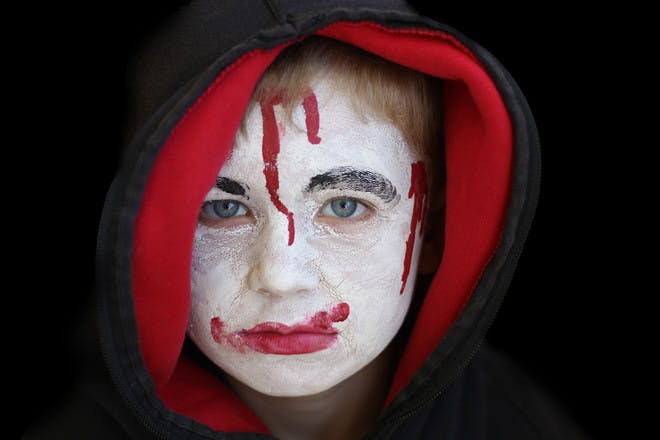Halloween face paint for a gory ghost