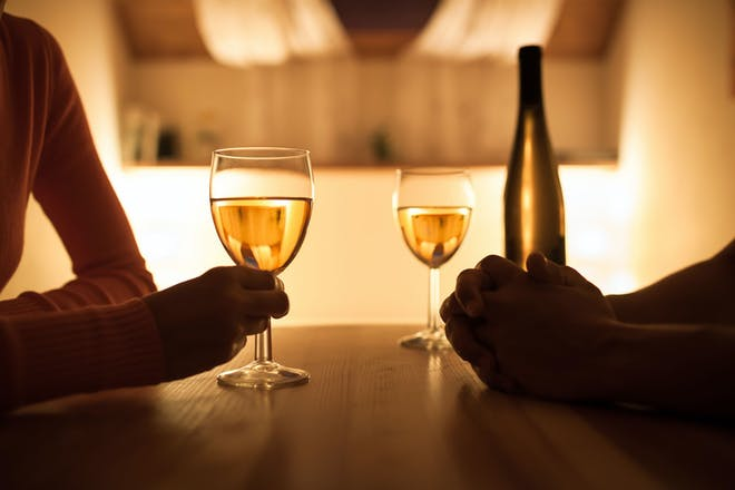 Couple chatting and drinking wine