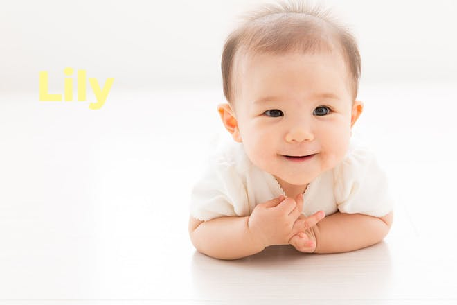 Smiling baby. Name Lily written in text