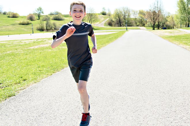 Young boy running in park