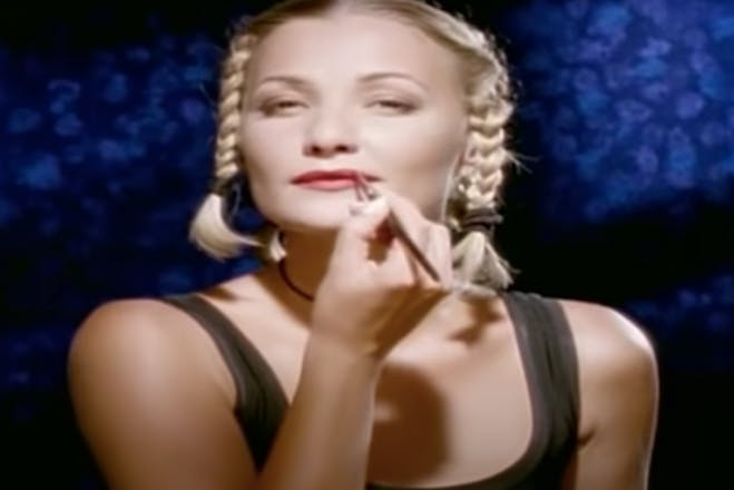 Still taken from Whigfield's Saturday Night showing her putting make up on