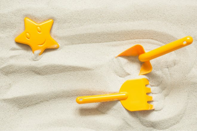 sand pit with toys in