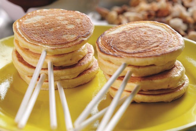 Lollypop pancakes. An easy pancake recipe for kids, featuring mini orange pancakes on sticks with chocolate dipping sauce. Try this recipe for Pancake Day