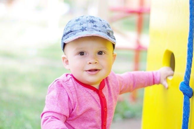 little boy wearing cap