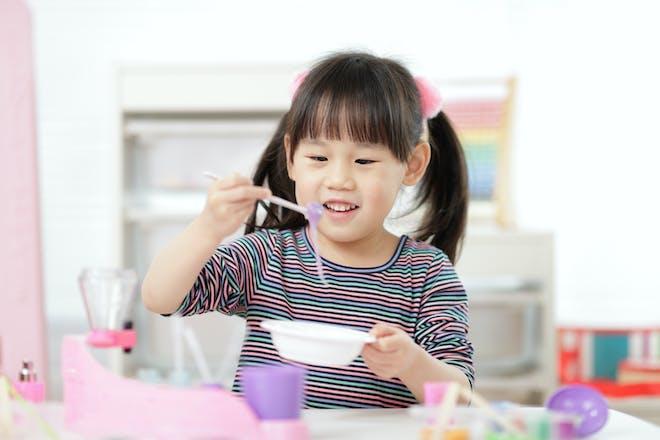 Little girl making biodegradable glitter glue