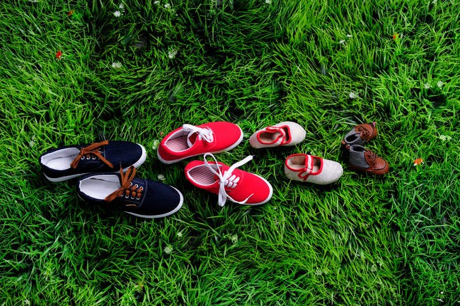 Family's shoes on grass