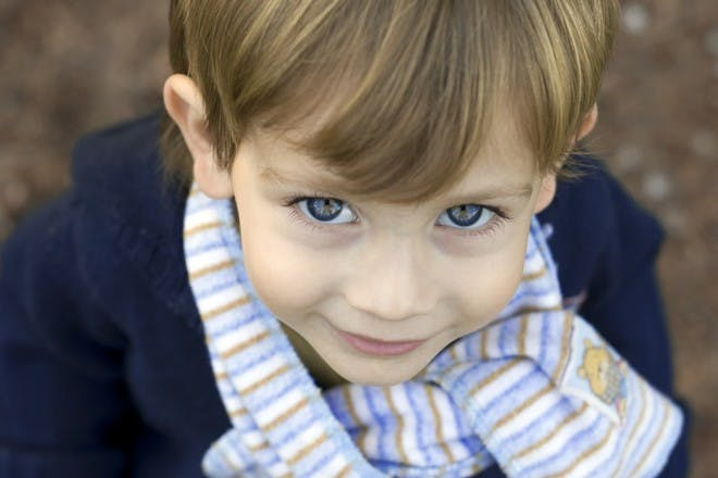 child wearing scarf looking up